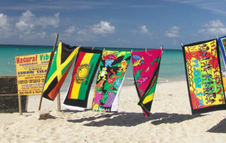 jamaican flags on a beach