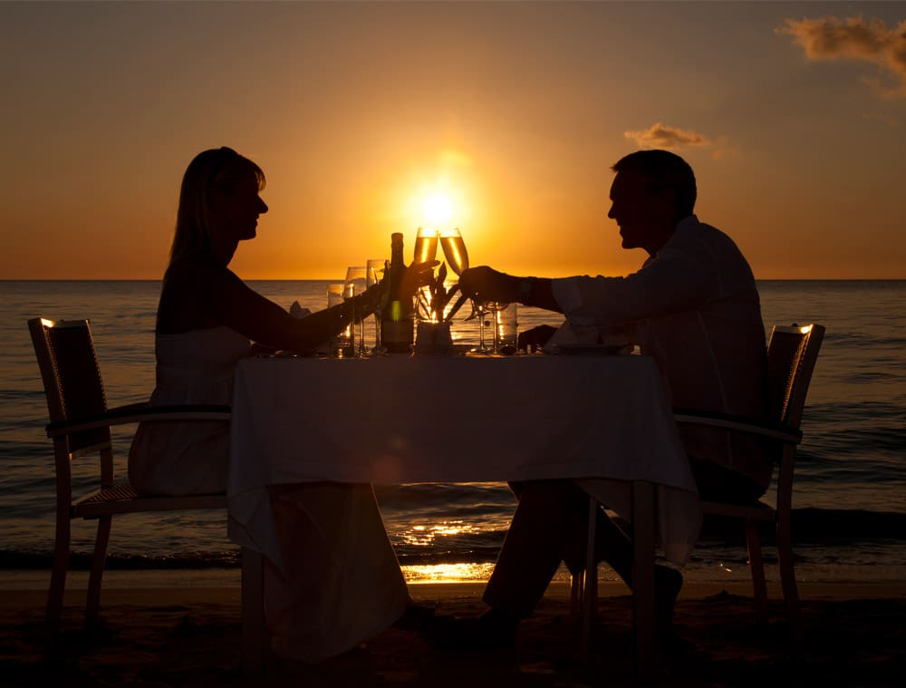 A couple dining on the beach